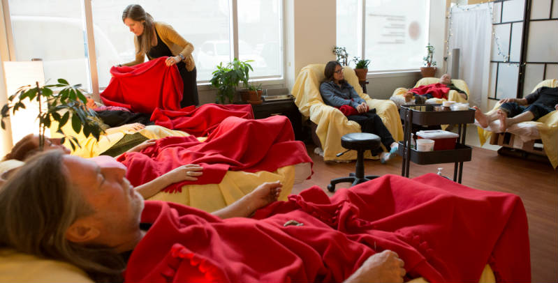 Several patients napping while Steph blankets another